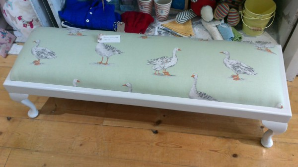 upholstered footstool by Iain