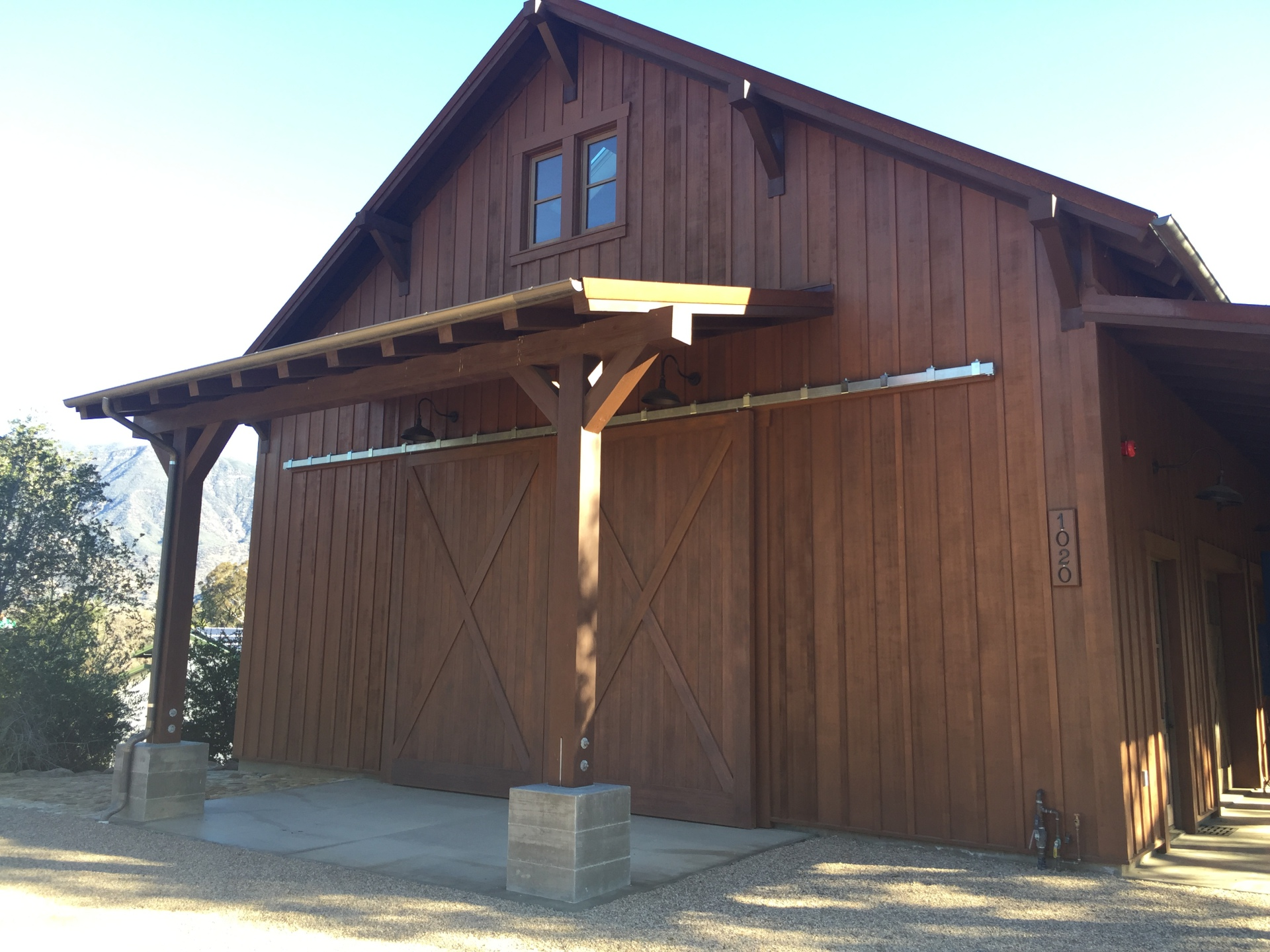 Custom Carriage House Rolling Barn Doors with individual motors