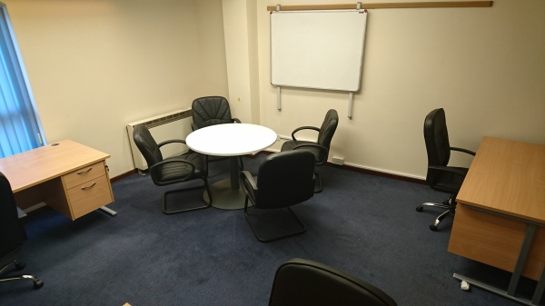 Ground floor office complete with meeting table