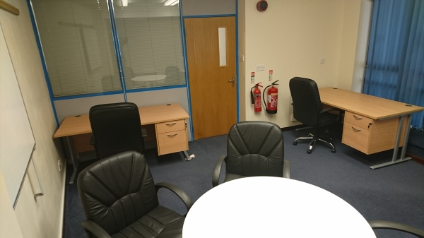 Ground floor office with meeting table