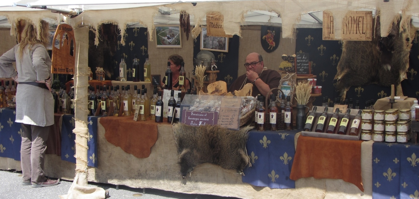 selling wares at medieval festival in Domfront 2015