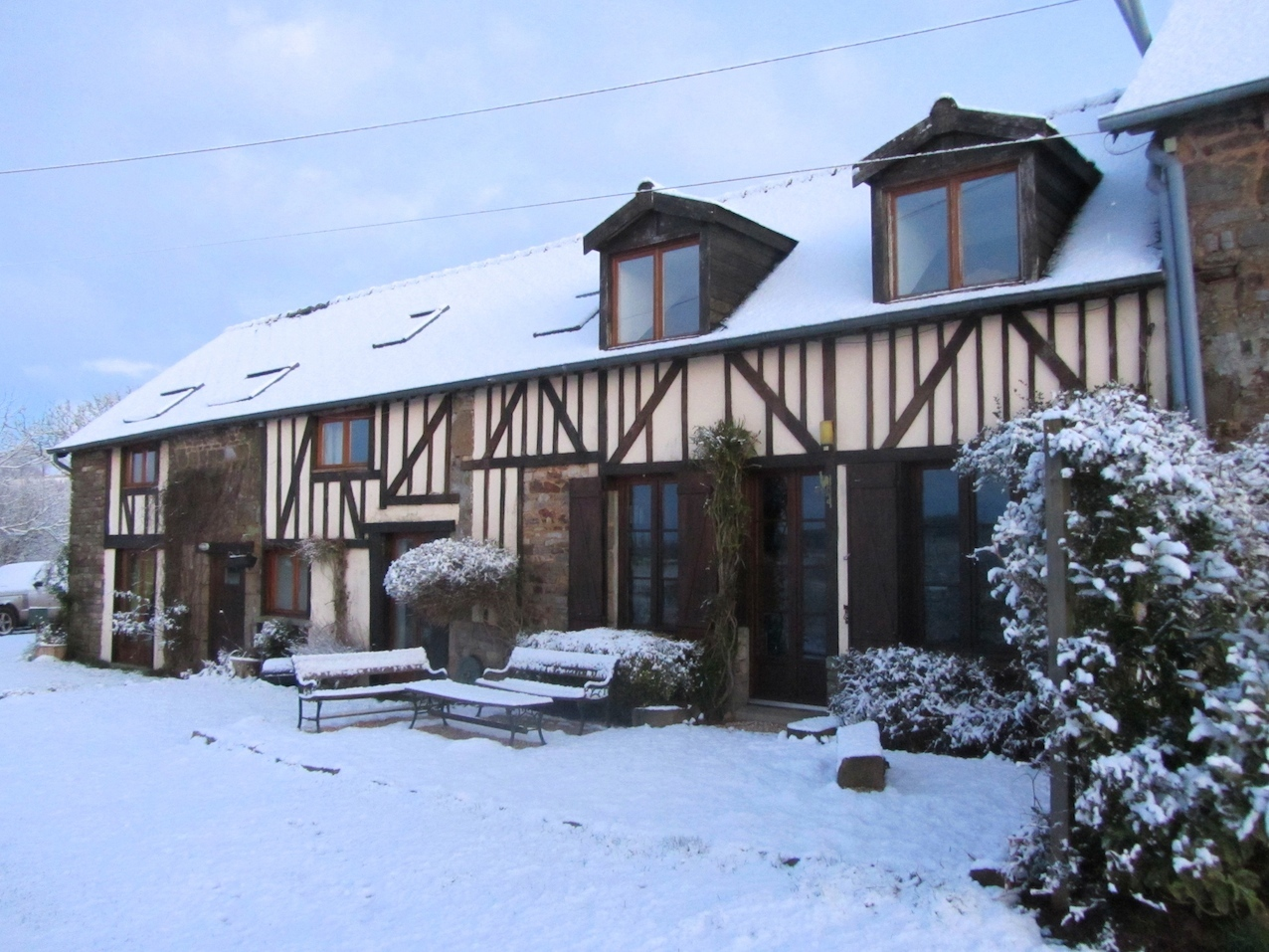 snow-covered gite at Le Choisel, Normandy, France