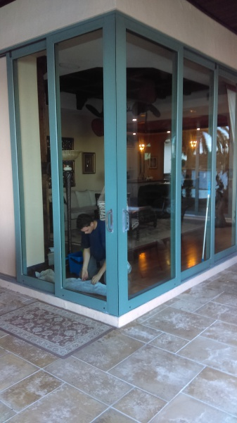 Cleaning tall glass doors