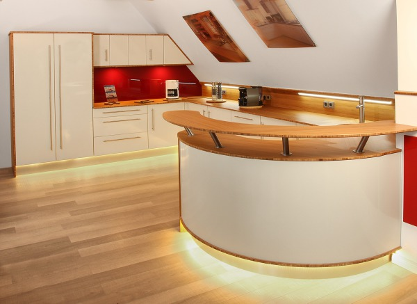 Modern Illuminated cream colored Kitchen with LED under cabinet lighting