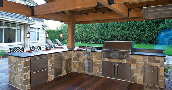 Outdoor stone kitchen with gas grill, stainless drawers, cabinets and granite countertops