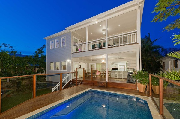 Pass through wetbar through kitchen fold back window.  Decking and railing around pool and back of house patio.