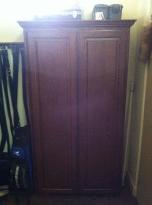 Custom built hardwood gun cabinet