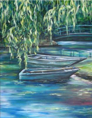 two empty boats int he water near a bridge