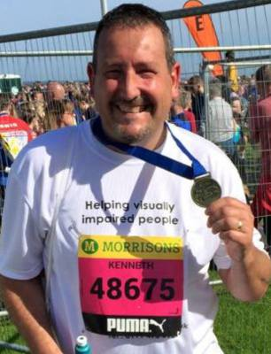 Kenny Piper at the finish line of Morrisons Great North Run 2015