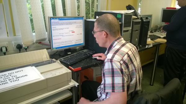 Visually Impaired man using digital technology