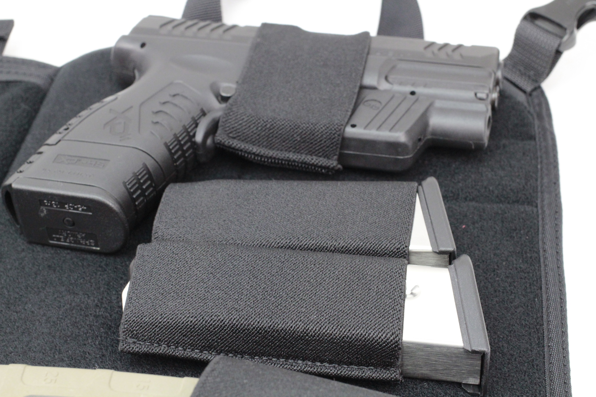 Large Tactical DASH bag with pistol holster and extra mags close-up