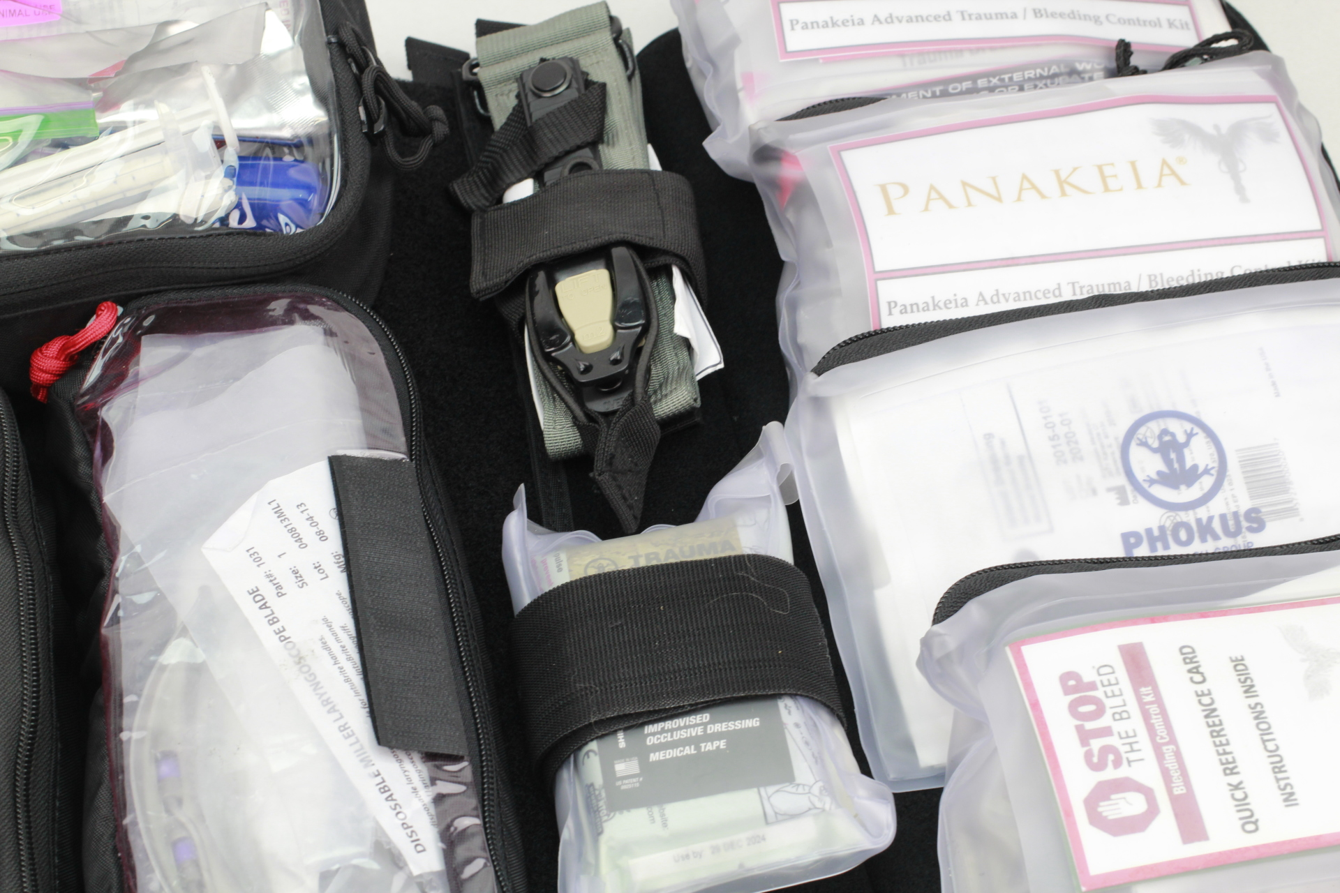 Large Civilian DASH bag close up with RevMedx TQ on inside spine and Panakeia Bleeding Control Kits