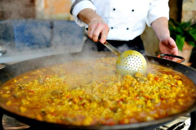 cooking paella spanish food