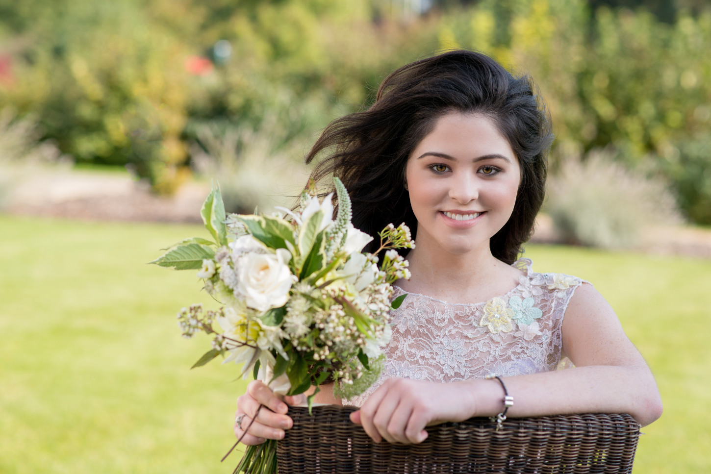 Beautiful bride with natural wedding makeup holding her stunning bouquet of flowers
