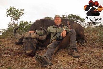 "<img src=""image.png"" alt=""Buffalo bull shot with rifle"">"