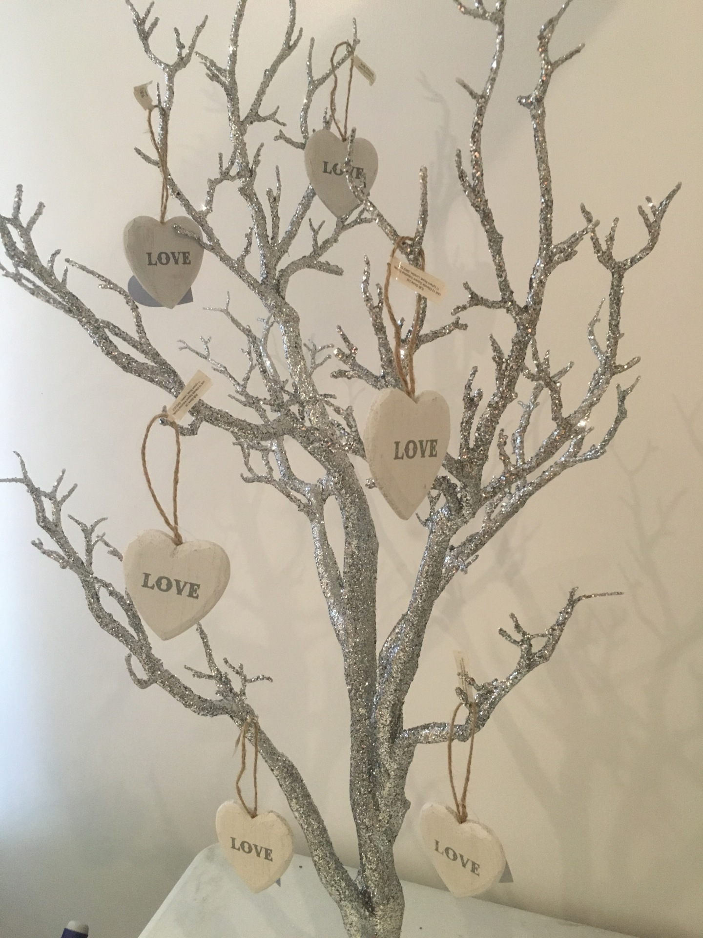 Silver manzanita trees and hanging heart decor
