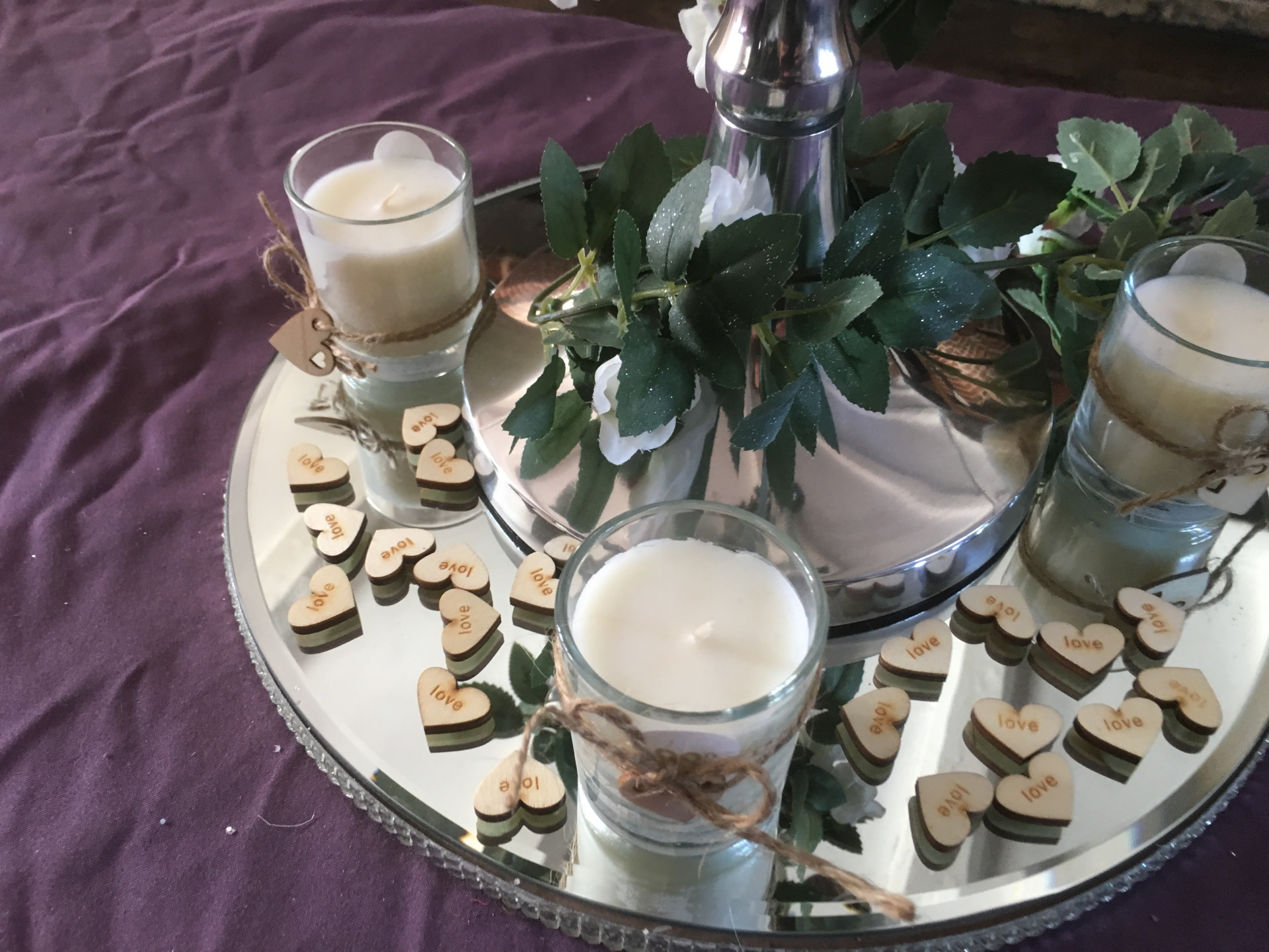 Silver candelabras with mirrored plate, rose vine and shabby chic votives & scatter hearts