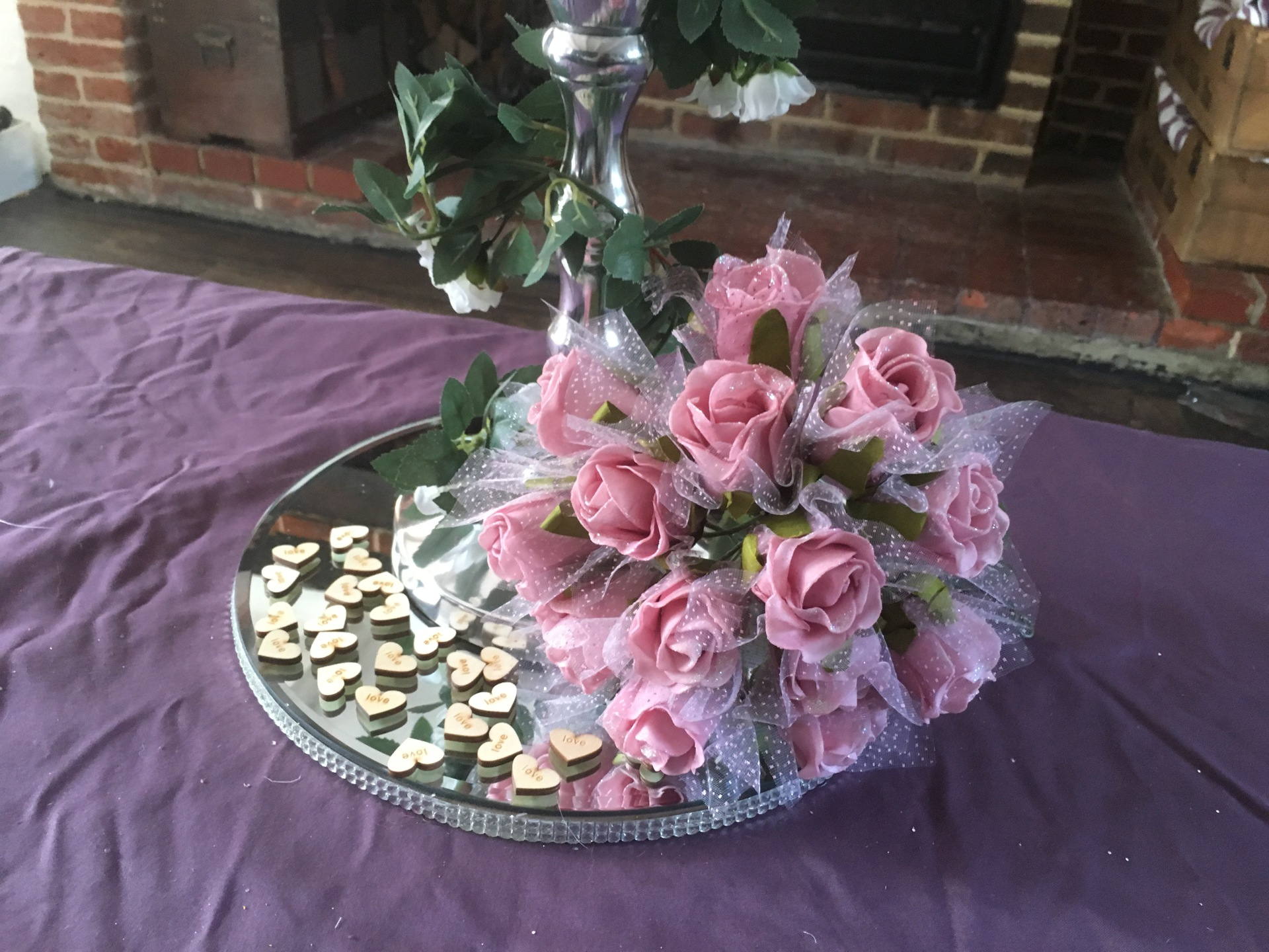 Mirrored plates shown with flower Detail and wooden heart scatters
