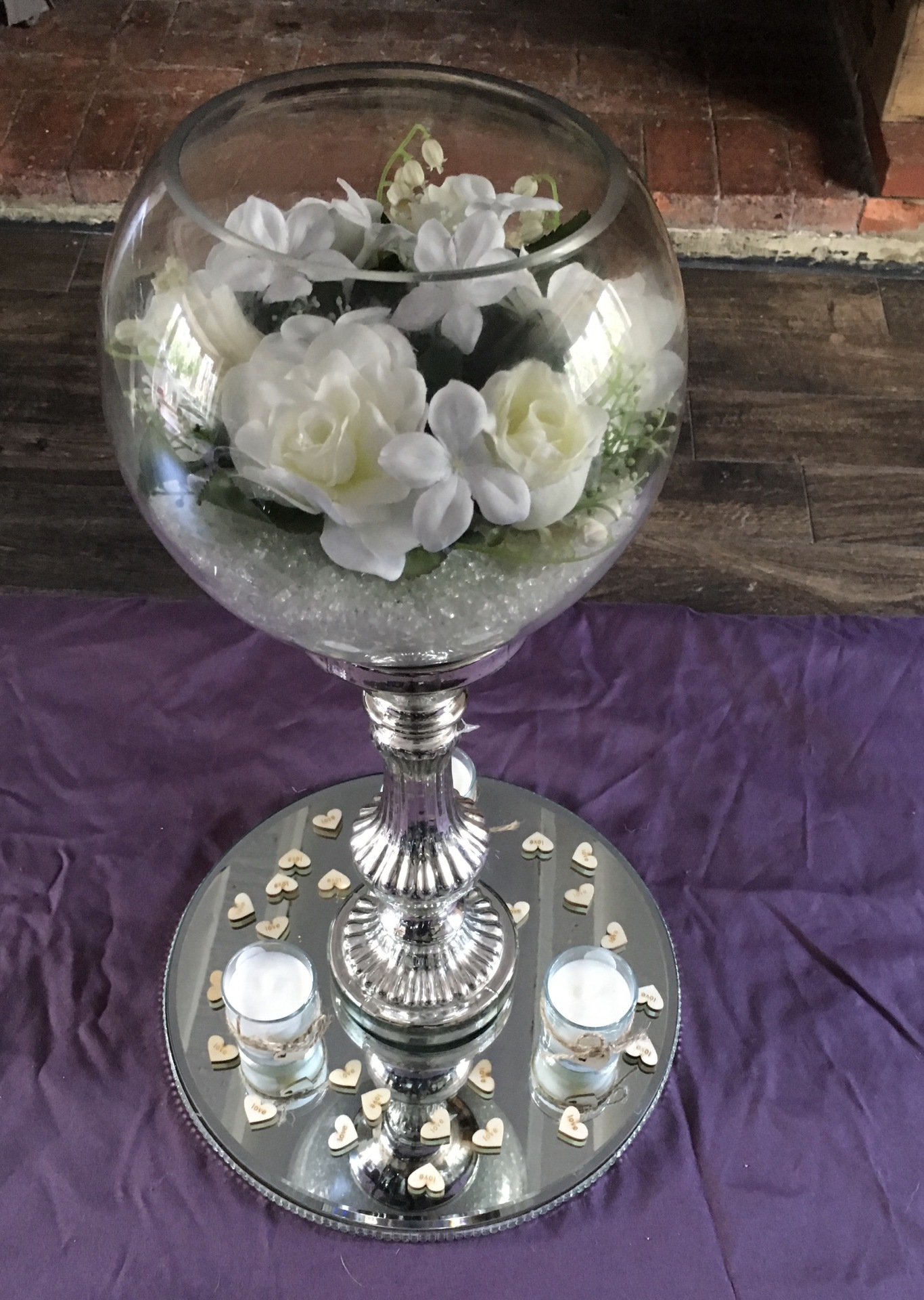 Fish bowl supplied with stand, mirrored plate, shabby chic votives, scatter hearts & white flowers
