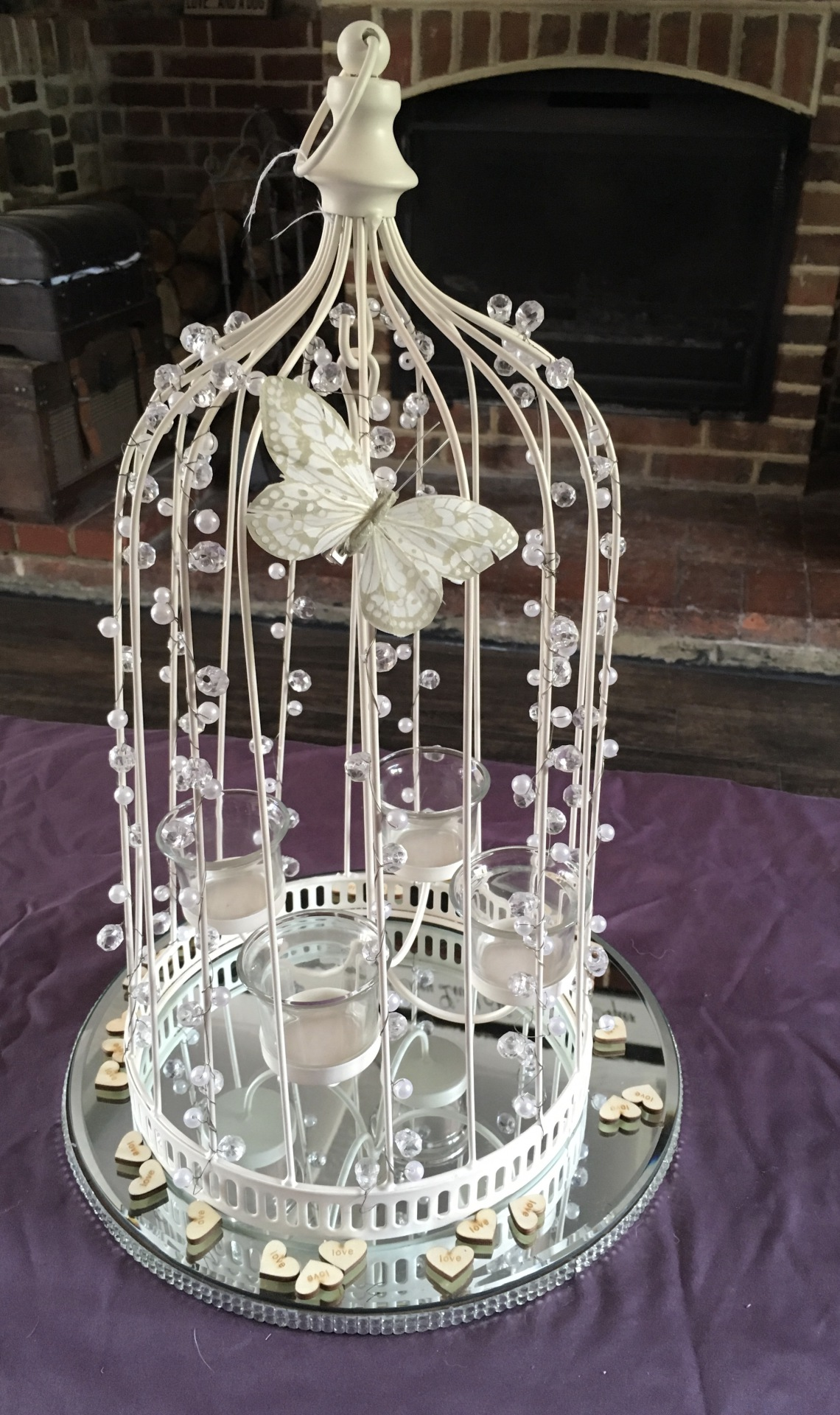 Beaded bird cage supplied with mirrored plate, led tea lights & butterfly decor