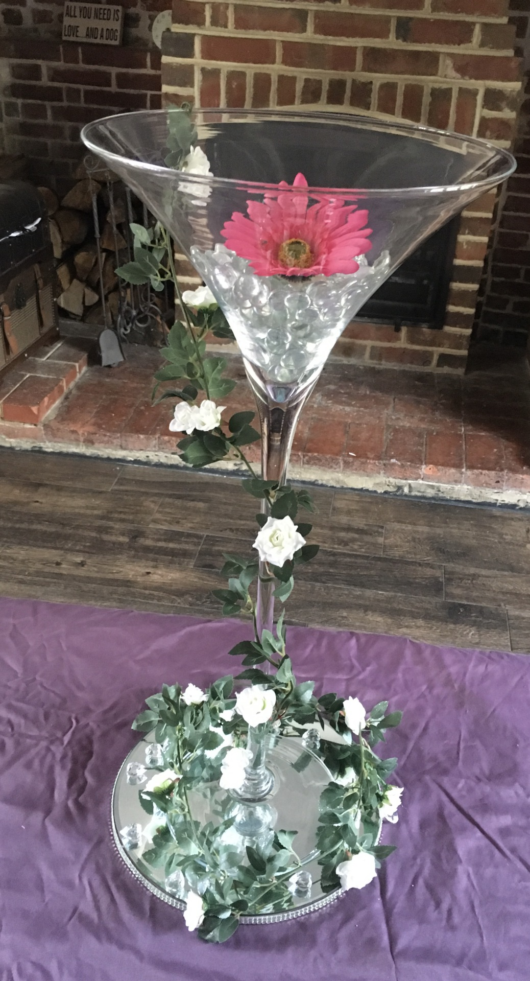 Oversized martini glasses supplied with mirrored plates, crystals & flower head