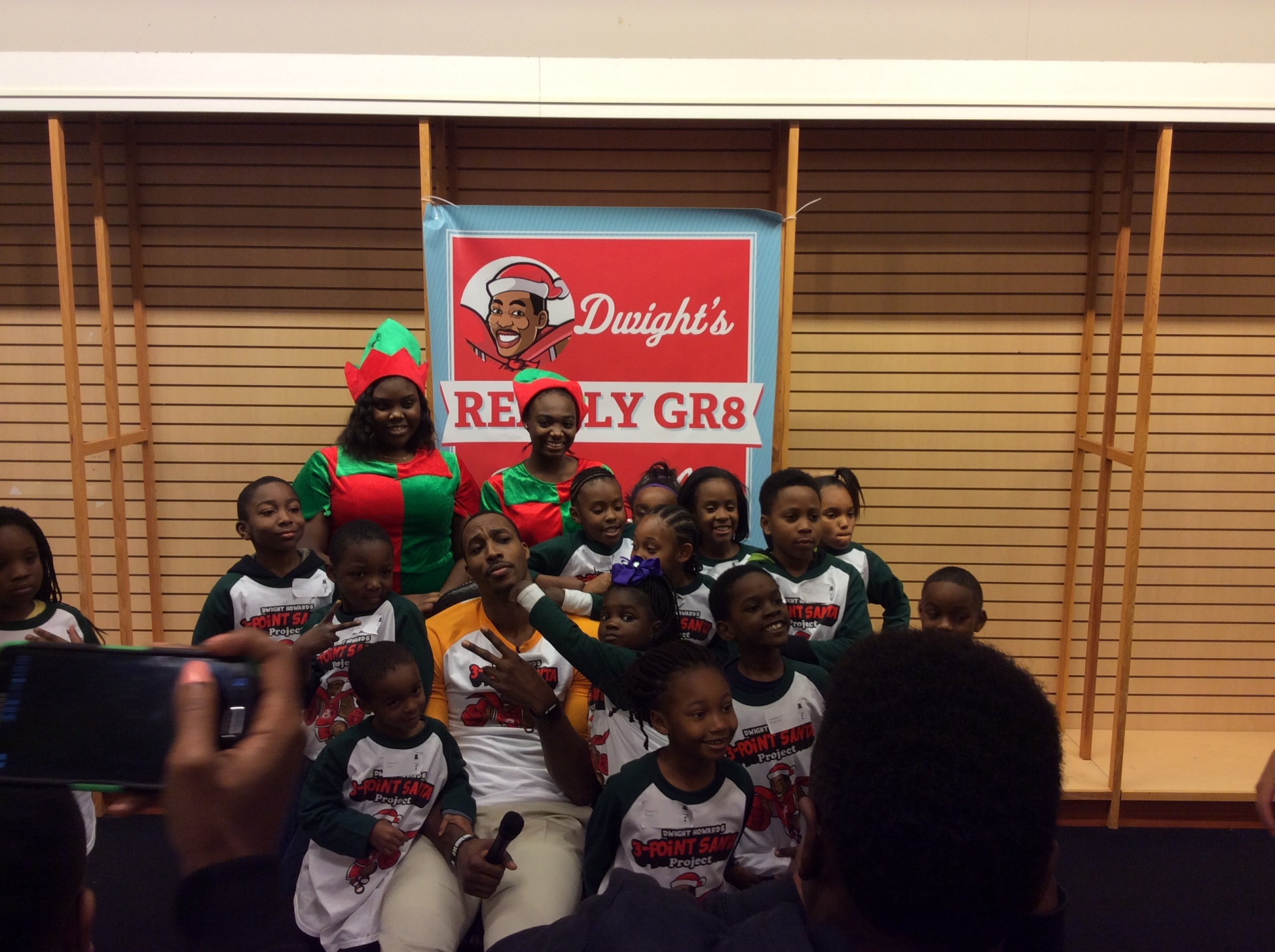 Dwight Howard poses with some of the kids that took part of his 3 point Santa event.