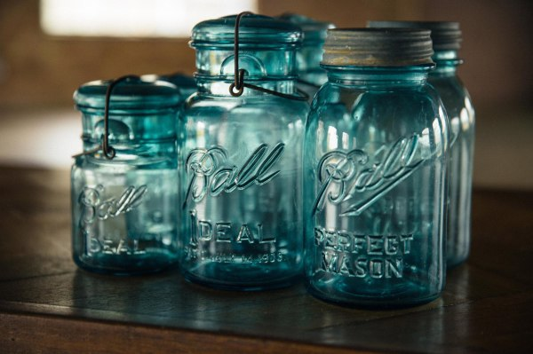 Glorious aqua glass jars, prefect for lighting candles in at weddings