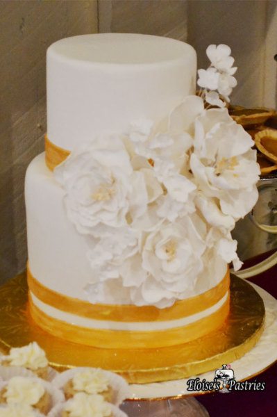 Gold and White Wedding Cake with Statement Flowers