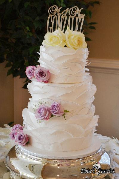 Elegant Wedding Cake with Ruffles and fresh Roses