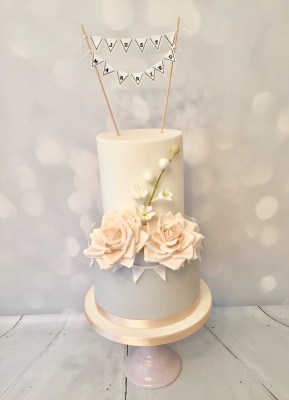 Wedding cake with ruffles lustre and royal icing detail