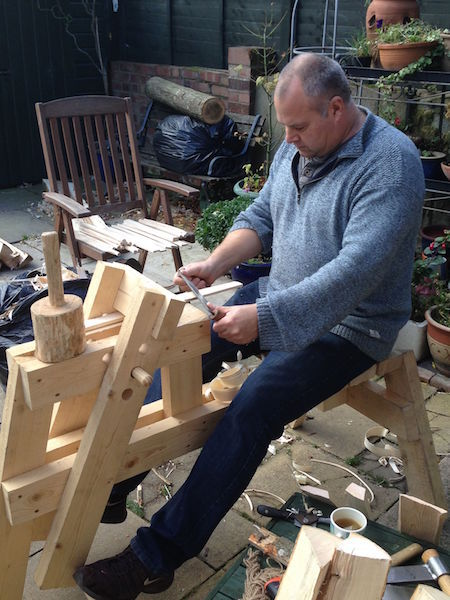 mark griffin sat on shaving horse, using a draw knife at rustic ash chairs