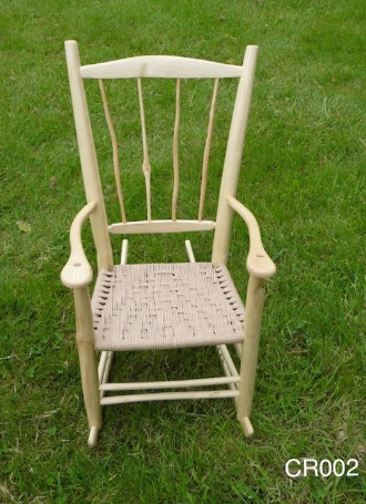 knotty wood rustic ash chair, spindle back rocking chair with grass background