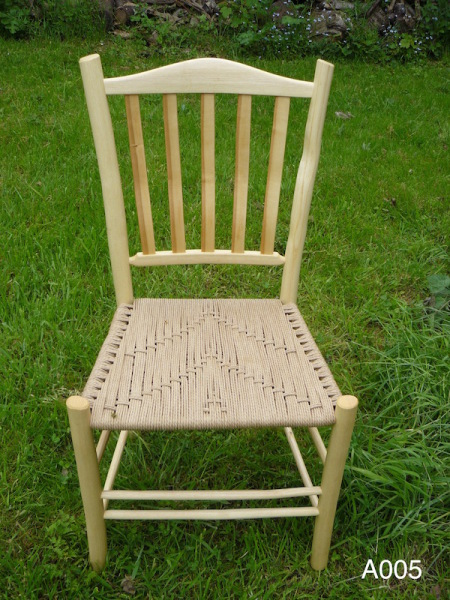 cherry lath back rustic ash wood dining chair with weave seat, grass background