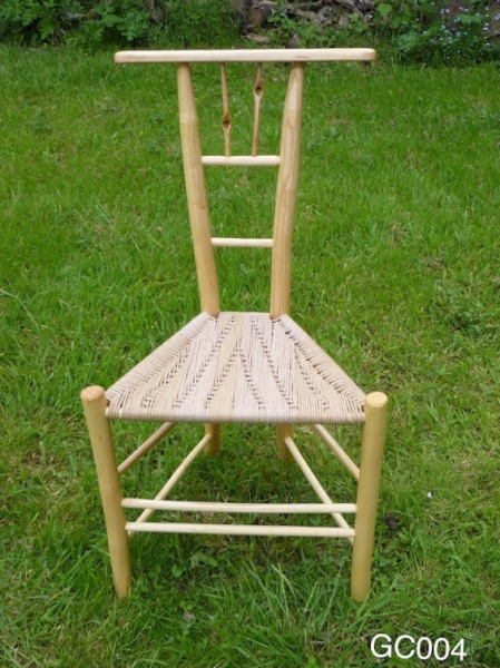 knotty gentleman's rustic ash chairs, unique design triangular chair on grass background