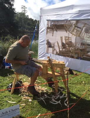 rustic ash chairs demonstrating a shaving horse at surrey hills woodfair 2016