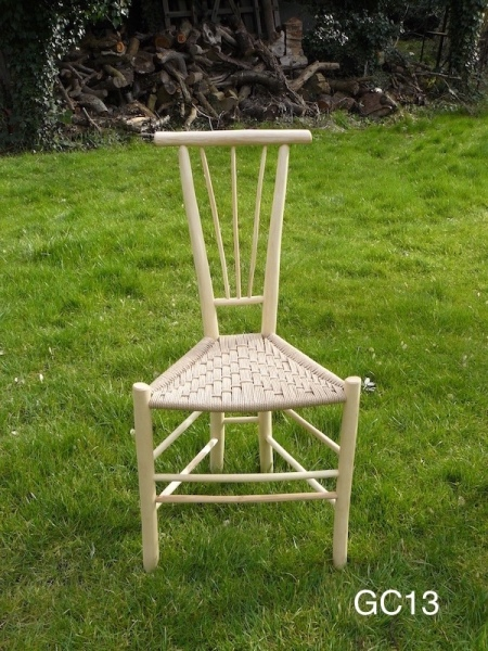 rustic fanned spindle gentleman's ash wood, unique design triangular chair on grass background