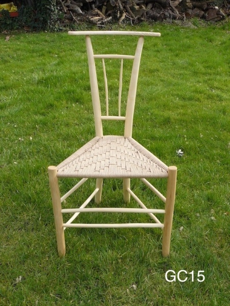 rustic spindles gentleman's ash wood, unique design triangular chair on grass background
