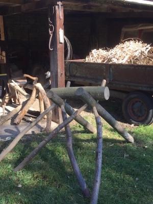 cleaving break for splitting logs, rustic ash chairs, wood shavings