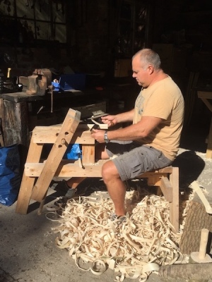 Mark Griffin using draw knife, shave horse at rustic ash chairs