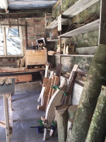 Rustic Ash Chairs workshop showing tools, woodworking jigs and ash logs