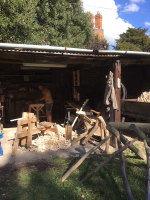 view of rustic ash chairs workshop in an old open fronted tractor shed