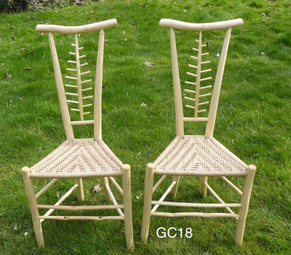 two matching pair leaf design Gentleman's chairs with curved back