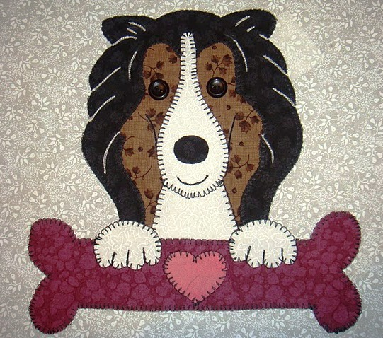 12 - Collie with bone