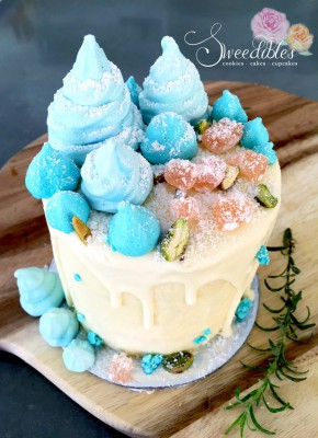 White Rocky Road Cake with blue rose water meringues