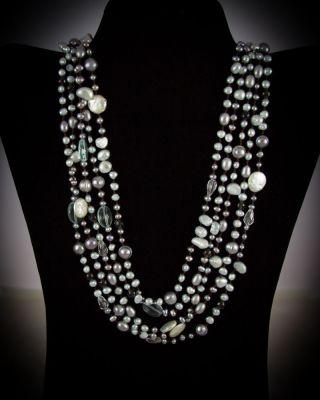 Multi-strand freshwater pearls with Aquamarine Qtz. bead