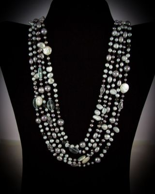 Multi-strand freshwater pearls with Aquamarine Qtz. bead