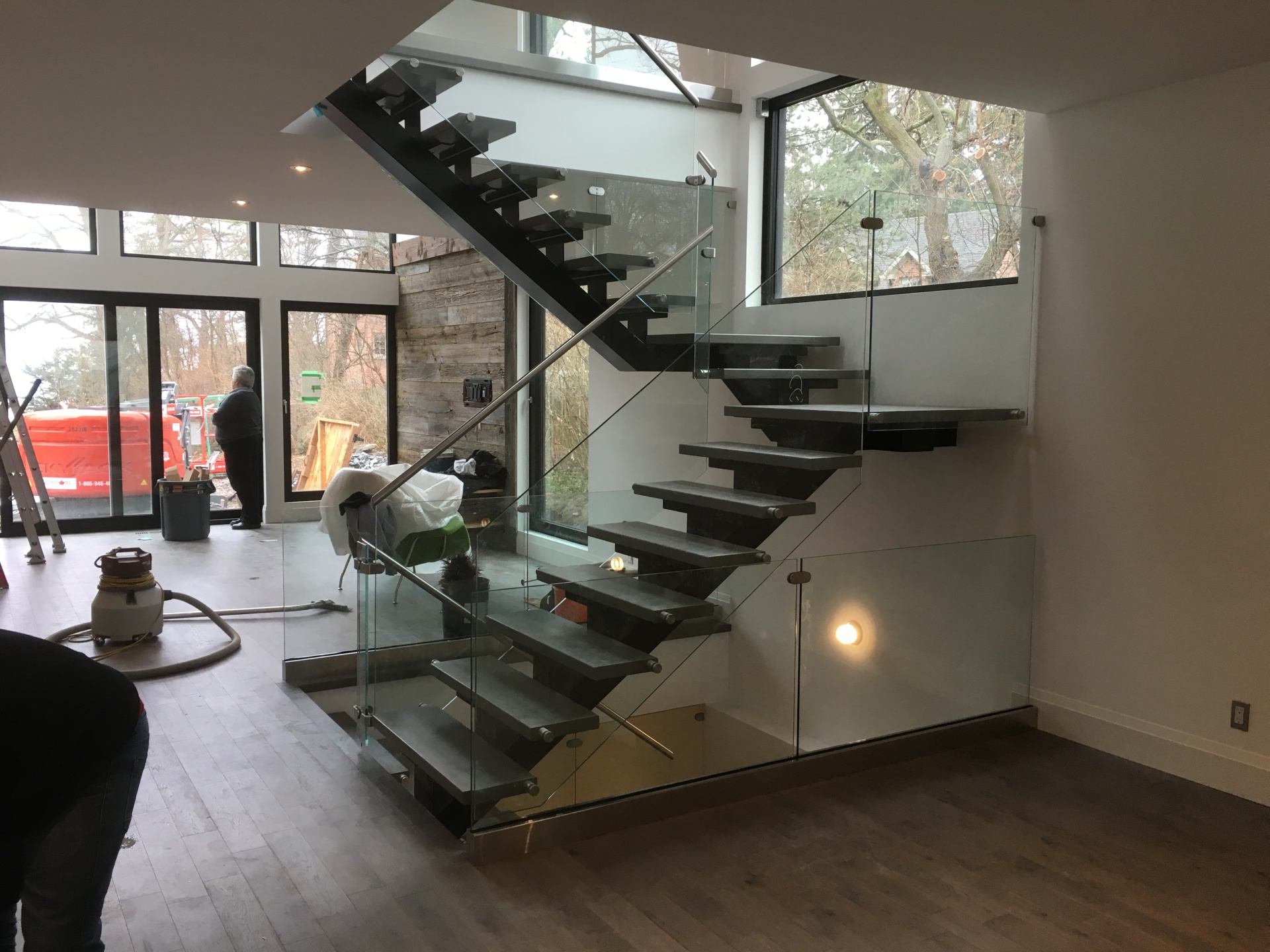 modern stairs with glass railings