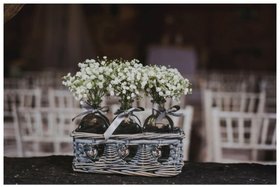 Simple touches of flowers in lovely holders