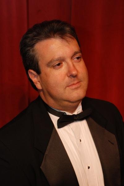 Michael Kerry Williams - Executive Director