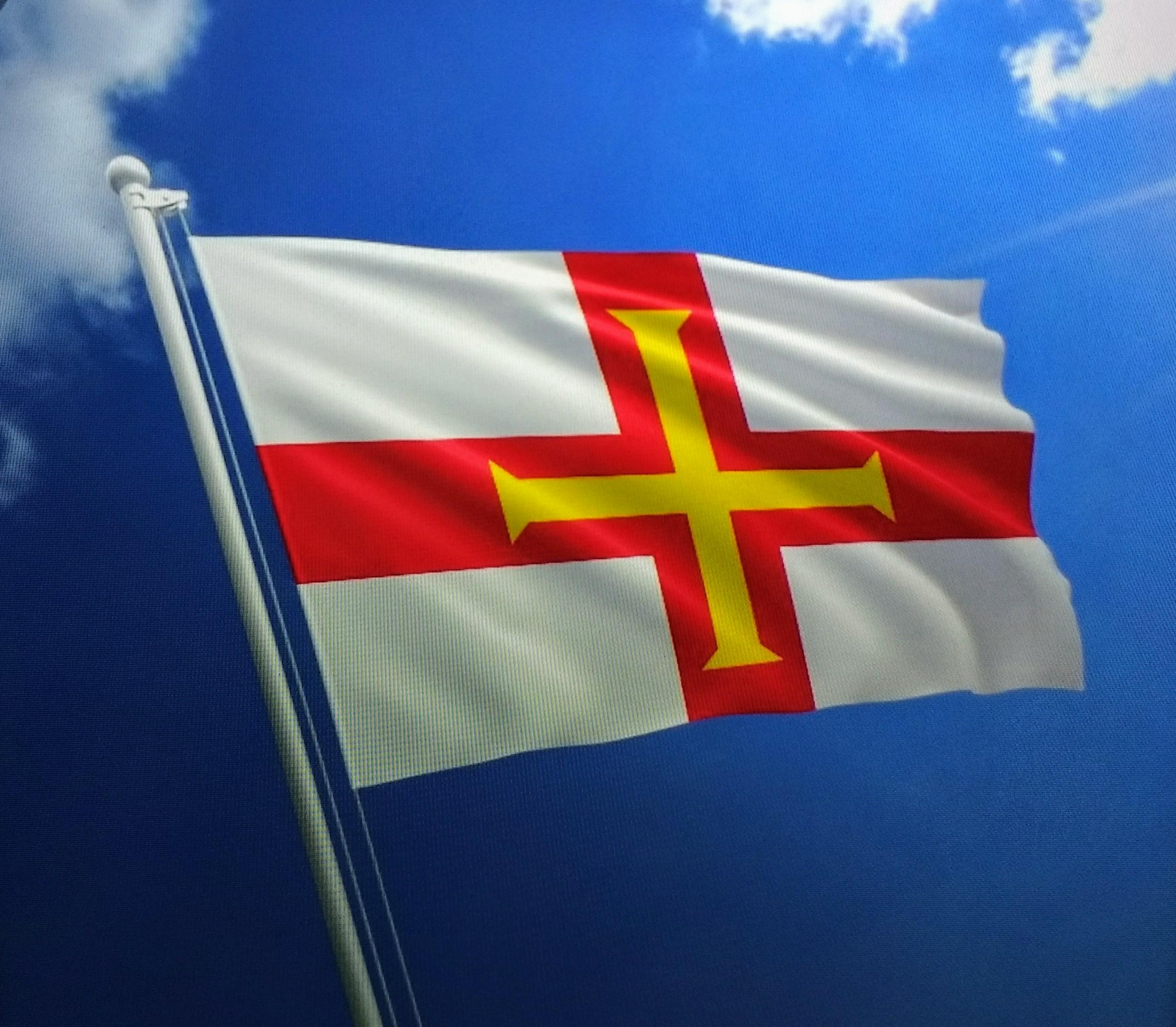 The Guernsey flag flies defiantly